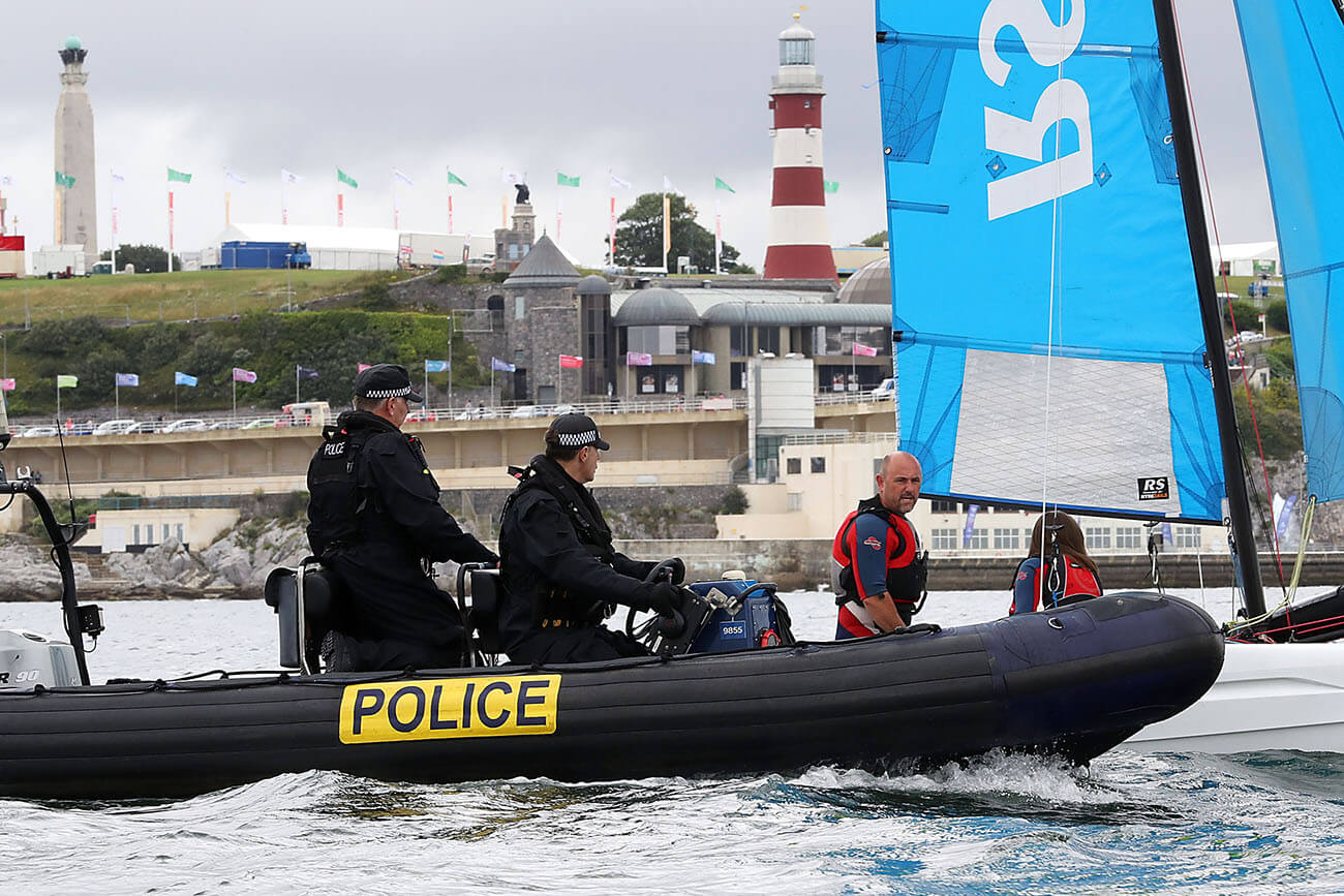 Meet the Queen's Harbour Master: Photograph of Naval police in a dinghy on the Plymouth Sound.